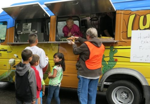 The Lunch Lizard food truck in Grand Junction is Colorado's eighth mobile summer food program, and its first on the Western Slope.  (Megan Arellano/CPR News)