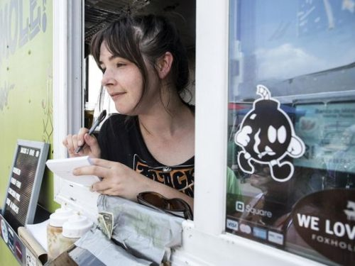 Rachel King stays busy as she mans the window of the Holy Mole Truck at the Flea Off Market on Saturday. 6/6/15(Photo: Marty Pearl/Special to The C-J)