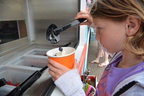 BRE MCGEE – STAR TRIBUNE  GalleryGallery: Kayla Jensen, 10, of Big Lake puts the finishing touches on her frozen yogurt sundae at the Fro Yo Soul truck.