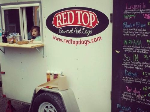 Harper Cohee, daughter of the RedTop Gourmet Hot Dogs owners Ryan Cohee and Rachel Pickerill, takes orders from the food truck established last year. (Photo: Ryan Cohee)