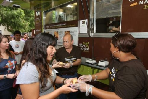 Photo By Dylan Aguilar/Houston Chronicle Olive Garden general managers Danny Gabaldon and Mary Jackson hand out samples of the new breadstick sandwich to Astros fans lined up outside the Minute Maid Park.  Wednesday, July 1, 2015, in Houston.