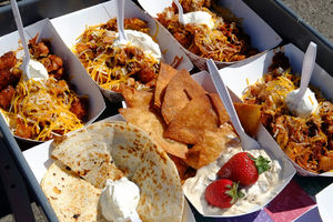 Jerk chicken tater tots, a pulled pork quesadilla and cookie dough dip are loaded onto a cart to be delivered to Waco Elementary teachers Wednesday. The Epic Cure food truck travels to the school twice a month to feed teachers who have few nearby lunch options.