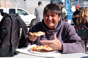 Siloam Mission patron Hank Williams enjoys a wood-fired pizza at today's event (Holly Caruk)