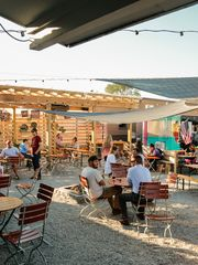 Patrons eat and drink at The Little Fleet food truck park/bar in downtown Traverse City on Tuesday September 22, 2015. (Photo: Ryan Garza, Detroit Free Press)