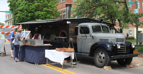 The Provender, a new food truck, parks at the Iowa City Farmer's Market on Saturday, May 2nd. The Provender specializes in wood-fired pizza and offers beer, root beer, and an assortment of wines. (The Daily Iowan;Rachael Westergard)