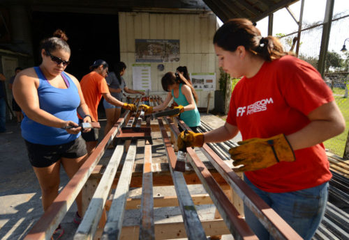 Brad Doherty  Texas Southmost College students began applying primer the metal framework and start the construction of a mobile market, Friday, Oct. 2,2015 in Brownsville. The mobile market will be used by local farmers to reach low-income families in Brownsville and provide locally grown vegetables to families for more healthy choices for their diets. (AP Photo/Brownsville Herald, Brad Doherty)