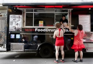 The Food Drunk Truck serves up burgers and more to hungry  Red Dress Run participants before Dirty Linen Night on  Royal Street in the French Quarter Saturday,  Aug. 9, 2014.  (Photo by Dinah Rogers, NOLA.com / The Times-Picayune)