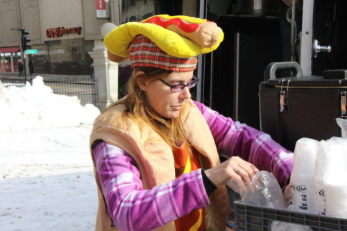 Charlene Guinard is dressed as a giant hot dog as she served free hot chocolate to people at Worcester Common.  The Dogfather food truck gave out the hot beverage.