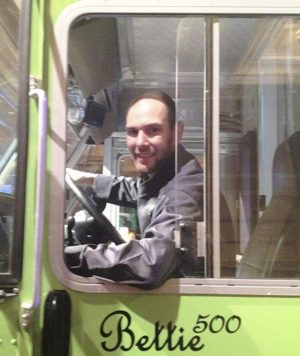 Travis Howard, a staff member of U.S. Potato Board's new food truck,  sits in the driver's seat of the truck, planned to be stationed in Denver.