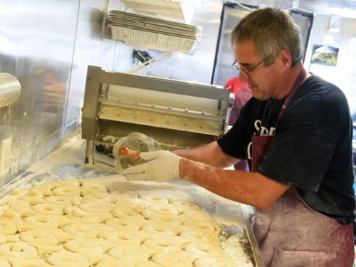 Ernie Schrock cuts donut shapes into the dough as he preps another batch of donuts while working inside the Strites Donuts' food truck. They are one of three food trucks parked in a lot behind Kline's Dairy Bar and open for business in Waynesboro on Wednesday, Sept. 9, 2015. (Photo: Mike Tripp/The News Leader)
