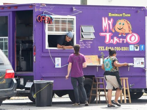 Horacio Pina, co-owner of My TaKito, speaks with costumer Tyler Abernethy of Crozet as fellow co-owner and wife, Veronica Pina, walks alongside their food truck. My TaKito is one of three food trucks operating in a lot behind Kline's Dairy Bar in Waynesboro on Wednesday, Sept. 9, 2015. (Photo: Mike Tripp/The News Leader)