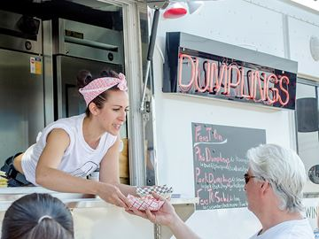 Food Truck Frenzy Metroland file photo WHITBY -- Stephen Bolohan got his food from Tanya  Casole-Gouveia, a server for the FeastOn Dumpling  truck during the Rotary Club of Whitby's  second Food Truck Frenzy.  Photo taken May 9, 2015. February 17, 2016