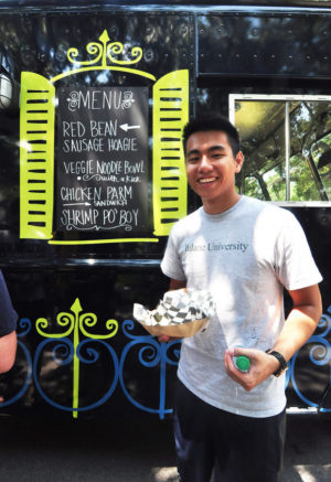 A Tulane student is all smiles as he  gets ready to enjoy his taste of local  cuisine from Roulez. (Submitted by Mike Strecker)