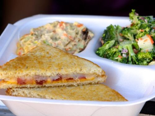 The Jersey Girl Super Foods food  truck features a variety of grilled cheese  sandwiches, including this one, the  Fort Monmouth, with bacon, tomato,  provolone and cheddar. Also  in the box: potato salad and broccoli  salad. (Photo: Chris Kridler/For FLORIDA TODAY)