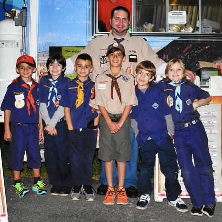 Cub Scout Pack 308 members, from left, Ryan Galinis, Michael Garafola, Tyler Albano, Mason Galinis,  Matthew Garafola and Samual Jones, and pack leader Michael Garafola, in back,  recently helped residents in the Boca Delray Country Club  with a food truck event.  (submitted photo / FPG)