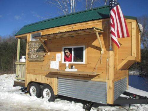 Matthew Glatz entices passing skiers from The SaltBox Cafe, open Thursday through Monday, on Sunday River Road in Newry.