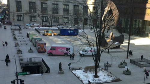 Food trucks set up at Daley Plaza for a weekly Food Truck Fest. (Credit: CBS)