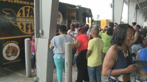 """Food Truck, Craft Beer Festival at the  State Farmer's Markert.  Here 'Too Fat To Fly""""  has customers lined  up.   This year the festival will be held at  the Fairgrounds to give more  space and help with traffic."""