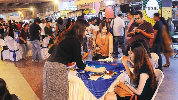 Bengaluru, IND: Bengalureans Treat Themselves at Truck Food at Street Fiesta