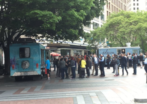 Food trucks in Seattle's Occidental Square on Wednesday. (Via @DvBnt Twitter)