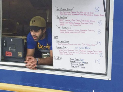 """David Mayernik Jr.   Tribune-Review Ricci Minella, owner of Burgh Bites, waits on  customers at the first """"Food Truck Friday"""" of  the summer in Heidelberg on May 20."""