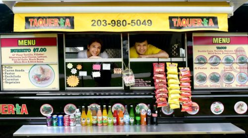 (Peter Hvizdak - New Haven Register) Employee Janina Torres (CQ),left, and  owner Beto Carvente of the  mexican food truck Taqueria Cinco, on the corner of Broad  Street and Church Street in Guilford Thursday, May 19, 2016.