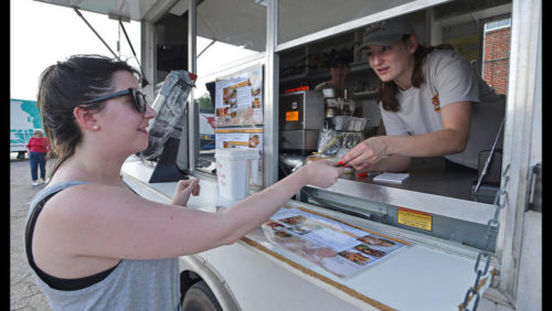 Cait Grose, of Mt Vernon in Baltimore, orders a Turkey Club  from T&J Waffles\' Daniela Perez-Roldan during a Food Truck Tuesday held at  Earleigh Heights Volunteer Fire Department.