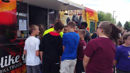 PHOTO BY RACHEL WITTROCK The Jordan City Council recently approved a policy  that would allow food trucks - such as this Outlaw Grill food truck  that recently visited the middle school - into Jordan.