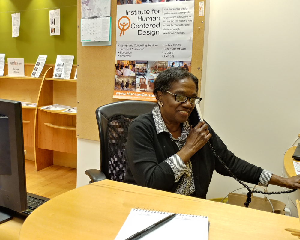 Sherll, IHCD's administrative assistant answering the phone.