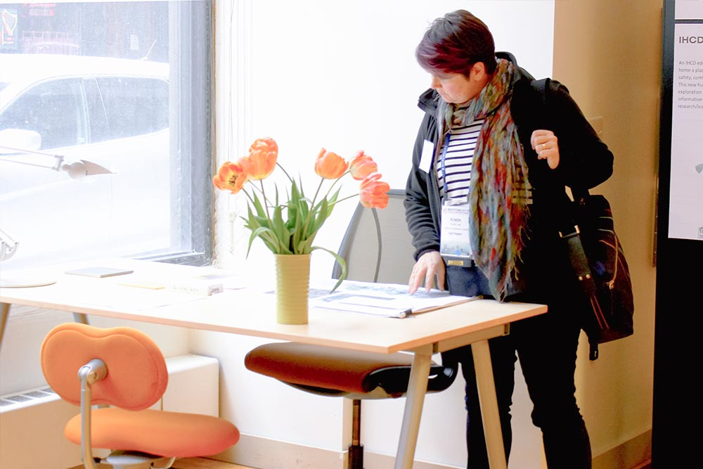 a woman reading about inclusive design in the home