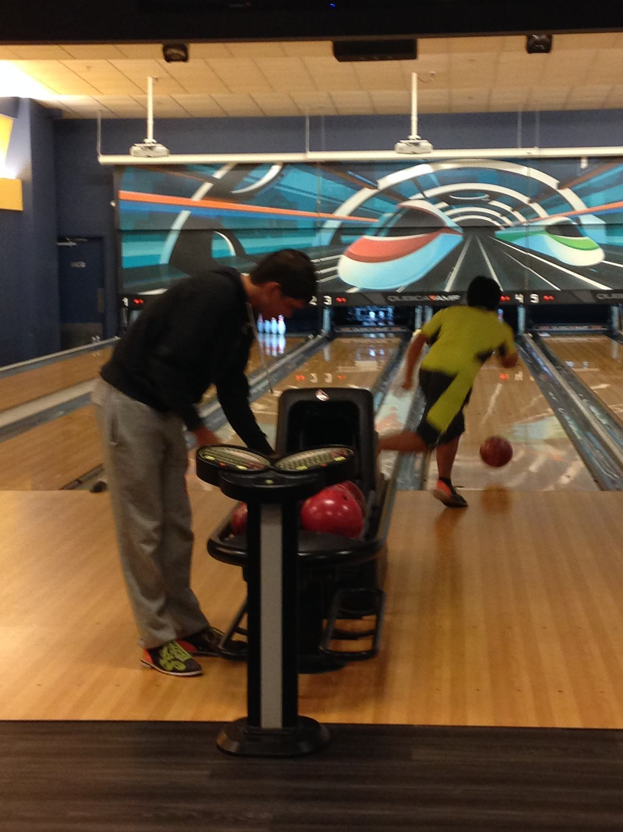 IJGA students Jack O'Donovan and Wataru Koguchi taking part in a trip to a local bowling alley.