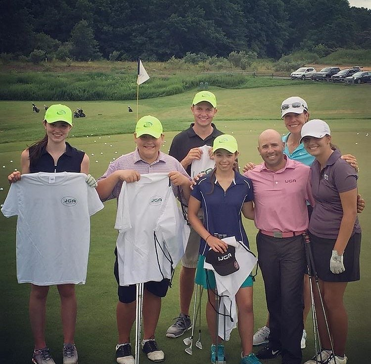 Coach Alex poses with students at Suzy Whaley Golf