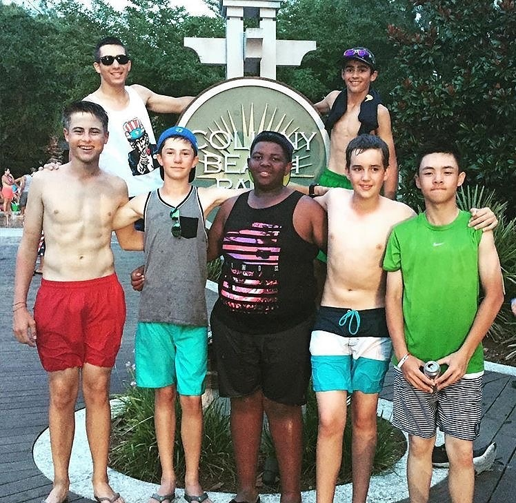 Group photo at the Coligny Beach sign