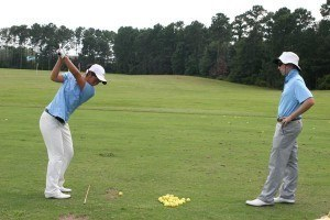 Coach John works with Yuna on the range