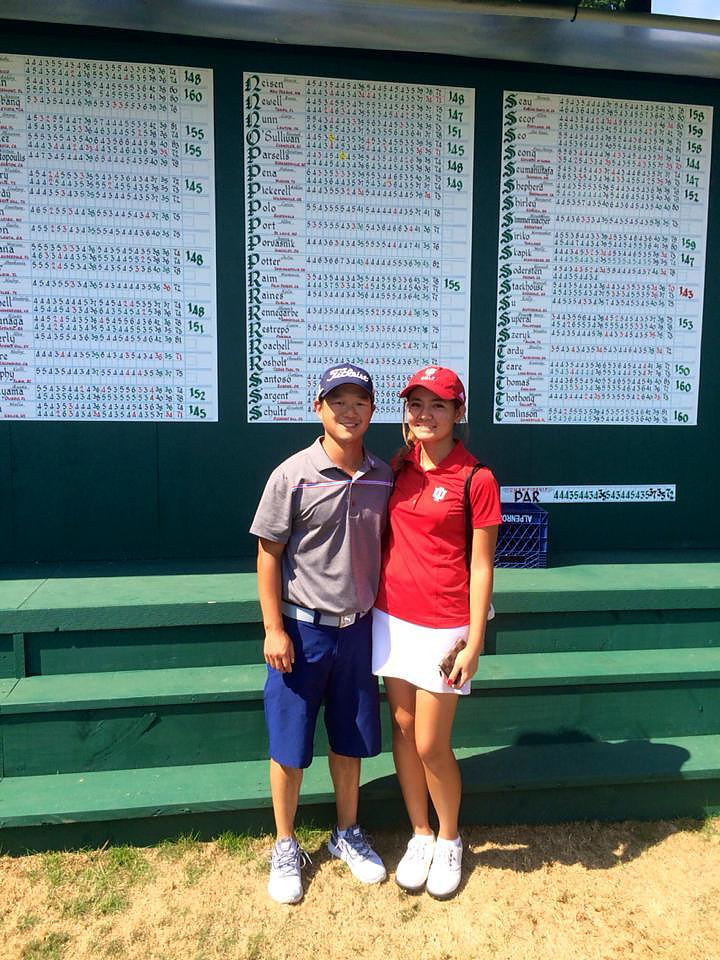 Pear poses with her coach and caddy Ross Prachar