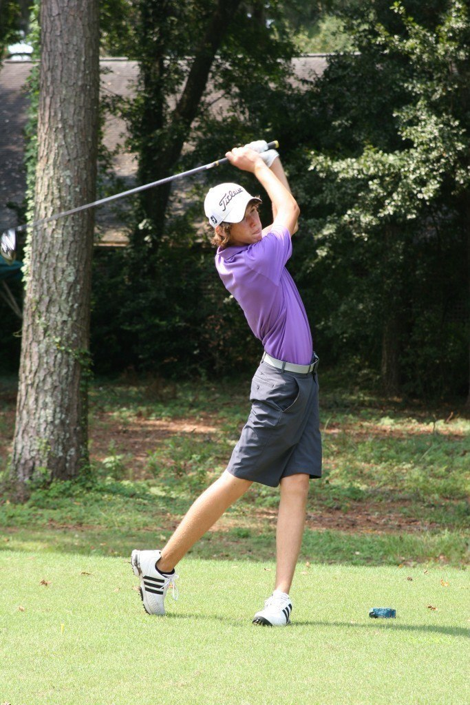Chase Phillips tees off during the HJGT Golden Bear Junior Challenge.