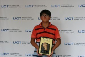 Adam Zou poses with his first-place trophy