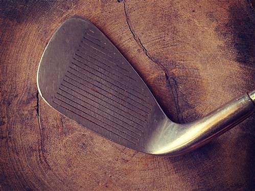 the head of an antique golf club
