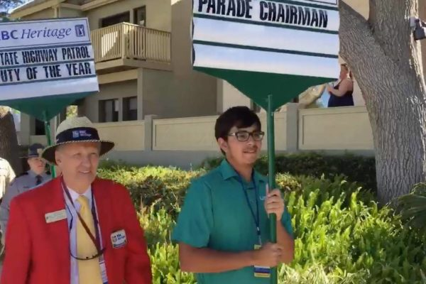Arjun Puri acts as the standard-bearer for parade chairman Courtland Babcock II.