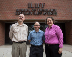 admissions team standing in front of Iliff's main building