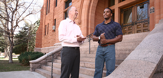professor and PhD student on Iliff steps