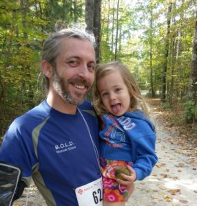 Kirt and Everly after he ran a half marathon trail race.