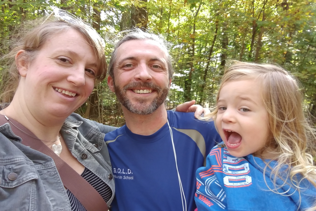Diane, Kirt, and Everly immediately after he ran a half marathon trail race.
