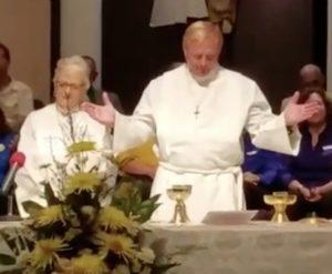 Craig serves communion.