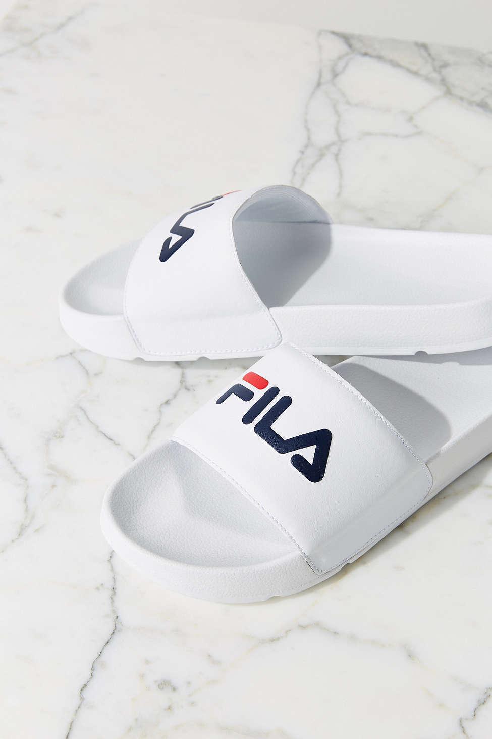 new fila swimming pool slide sandals buyma. Black Bedroom Furniture Sets. Home Design Ideas