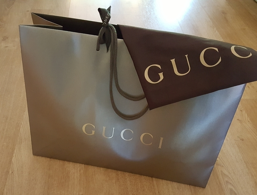 gucci handbags essay Gucci and louis vuitton are both classic brands right now, gucci is hot hot hot ever since they came out with the marmont bag in different colors, and their fun princetown slides, they have become the it brand for sure.