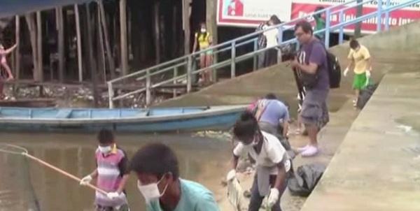 Iquitos: niños limpian orillas de río para celebrar festival