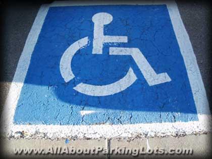 Poor Pavement marking 4 months later - Handicap emblem