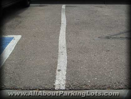 Poor parking lot striping 4 months later