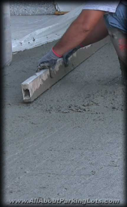 concrete repair contractor repairing concrete on a commercial property